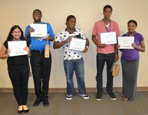 Graduates from the 2015 Manassas Project SEARCH program display their certificates of completion. From left to right: Maritza Rivers, Demetrius Wade, Patrick Robinson, Khayree Moore, and Jazmine McKevie. Not pictured are Yesica Langunas and Jewell Moore.