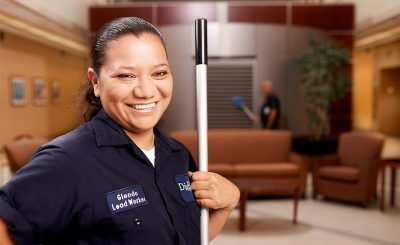 Woman at her job at a federal job site where she works through Didlake's Custodial Contract Services.