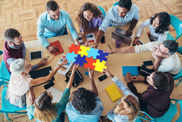 Work Team with Puzzle Pieces connected together