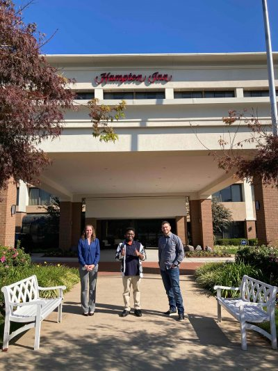 Jennifer Trey and Mike standing in front of the Hampton Inn Manassas, Virginia