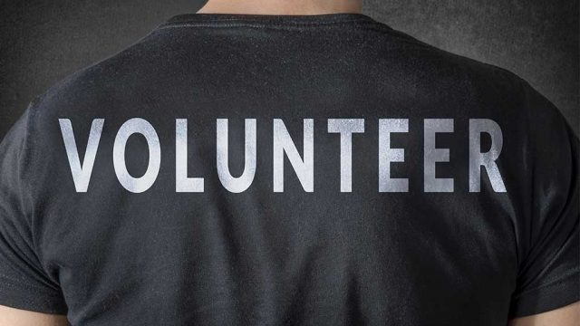 Volunteer benefiting from the value of volunteering with non-profit organizations.